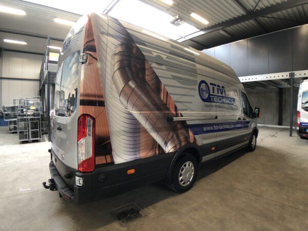 Beletteren bestelwagen van TM Technics.