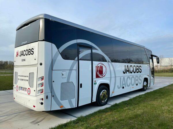 Bestickering bus voor Jacobs transport